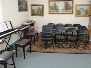 guitar-class-pianos-and-chairs